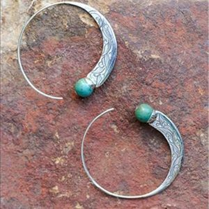 Great climber earrings. Turquoise stones.